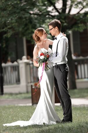 beautiful loving couple standing on the lawn in the city Park Stock Photo