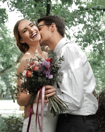 happy couple kissing on the background of the spring woods Stock Photo