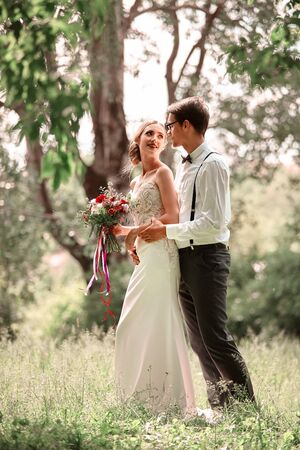 newlyweds walk in nature on the wedding day.