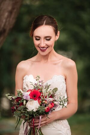 beautiful bride in a wedding dress and a wedding bouquet Stock Photo