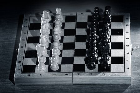 abstract composition of chess figures. prepared for start. mix of black and white figures