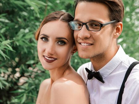 portrait of a beautiful young bride and groom