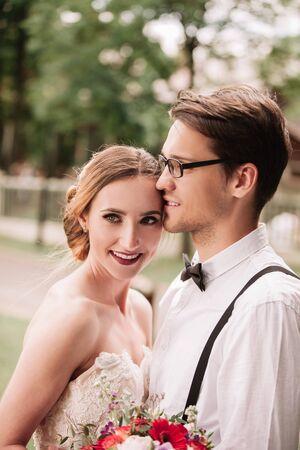 portrait of happy newlyweds on blurred background. Stock Photo