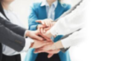 blurred image for the advertising text. business team showing their unity. the concept of teamwork Stock Photo