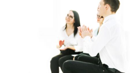 blurred image for the advertising text. employees applaud during a business meeting in the office. photo with copy space