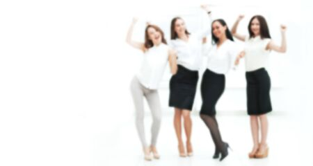 blurred image for the advertising text. full-length portrait of the triumphant business team.teamwork. Zdjęcie Seryjne - 132246745
