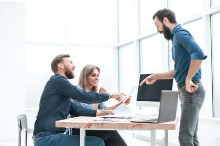 group of business people discussing something near the office Desk Banco de Imagens