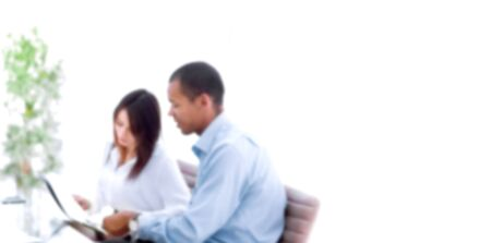 blurred image for the advertising text. photo with copy space. business colleagues discussing documents sitting at Desk