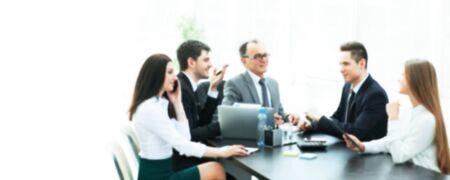 blurred image for the advertising text. photo with copy space. Manager and business group discussing financial documents