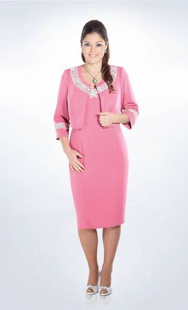 in full growth. elegant woman in a stylish pink suit.