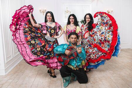 portrait Gypsy folk ensemble in traditional costumes