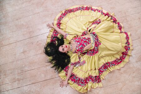 top view. young woman in a beautiful dress singing a passionate Gypsy dance Stock Photo