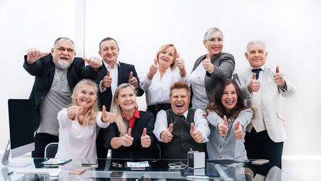 large group of happy employees showing their success