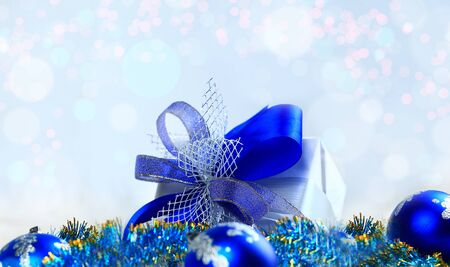 Christmas gift and blue balls on white background.