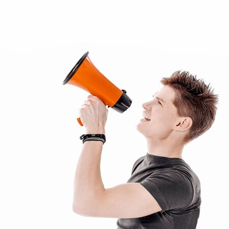closeup.modern young man with a megaphone. isolated on a white background.