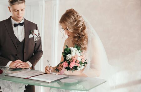 bride and groom signing the marriage contract.
