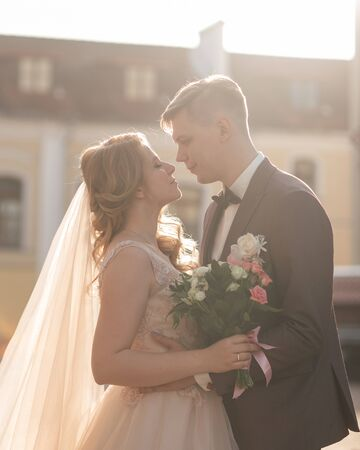 bride and groom look at each other tenderly. holidays and events