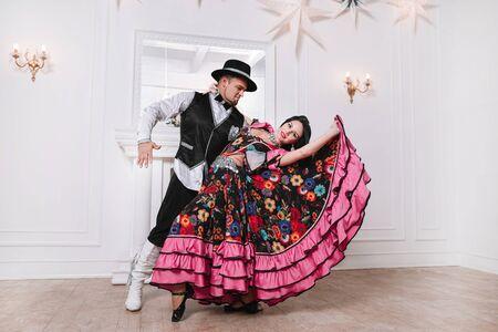 beautiful woman takes the Gypsy folk dance