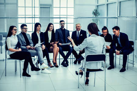 businesswoman makes a report at a meeting with the business team.