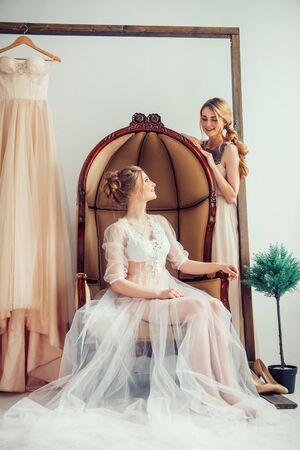 bride in wedding salon trying on wedding dress.