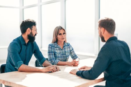 managers and job seeker sitting at the table during the interview