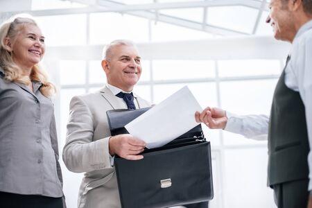 close up. businessman receiving document from Bank employee. Zdjęcie Seryjne