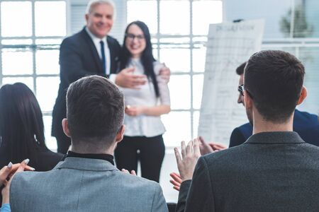 boss introducing a speaker at a business presentatio Stock Photo