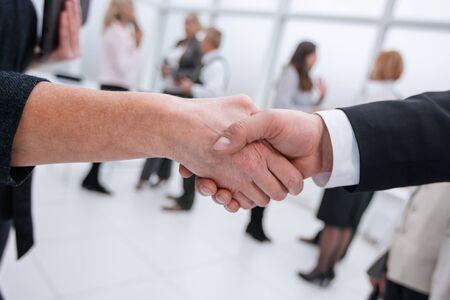 close up. businessman and businesswoman shaking hands . business concept