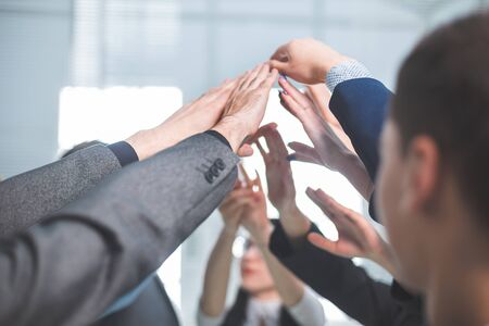 close up. a group of employees joining their palms