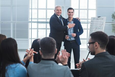 project Manager congratulating the best employee of the company