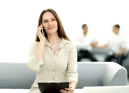 young business woman talking on a smartphone
