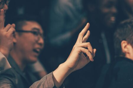 close up. young entrepreneur asking a question to a speaker 版權商用圖片