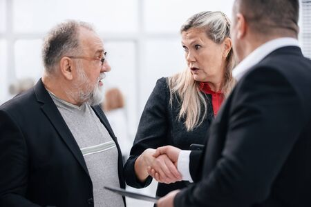 close up. businessman and businesswoman greeting each other with a handshake