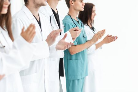 close up.a team of leading medics applauding together Stock Photo