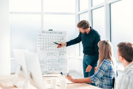 project Manager explaining to employees the new strategy of the company . photo with copy space