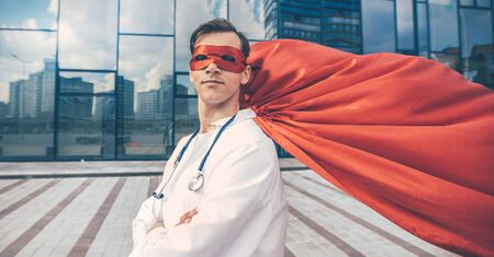 close up. doctor superhero confidently looking forward.