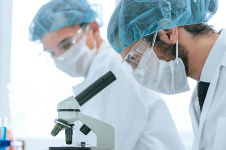 close up. a group of scientists working on creating a new vaccine.
