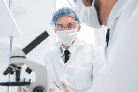 group of scientists discussing the results of testing. Stock Photo