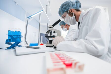 group of scientists conducts research in the laboratory . Фото со стока