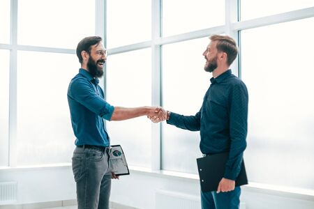 business people shaking hands before starting a business meeting Фото со стока