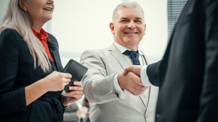 close up. confident business people shaking hands with each other.