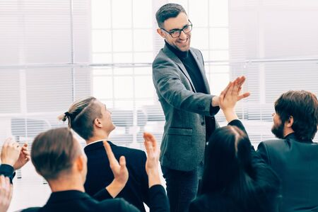 business colleagues giving each other a high five
