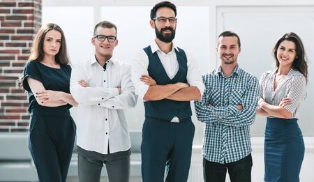 professional business team standing in spacious office