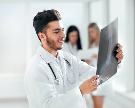 successful pediatrician standing in the hallway of the medical c