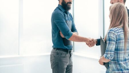 handshake business people in the office lobby . concept of cooperation