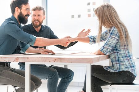employer shaking hands with a new employee during the interview