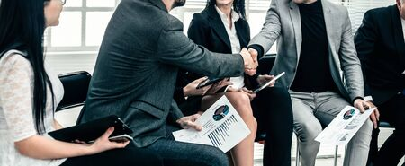 business colleagues shaking hands at an office meeting. concept of cooperation