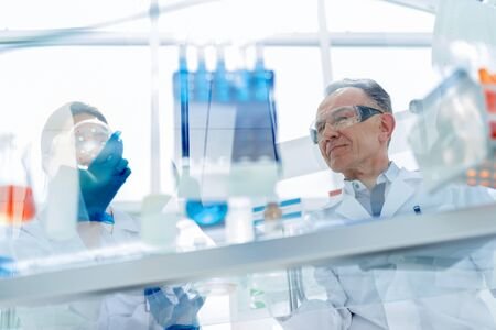 employees of a scientific laboratory testing a new vaccine . Stock Photo