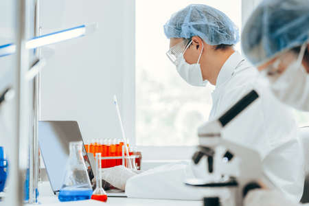 close up. scientist using a microscope in the laboratory. Stock Photo