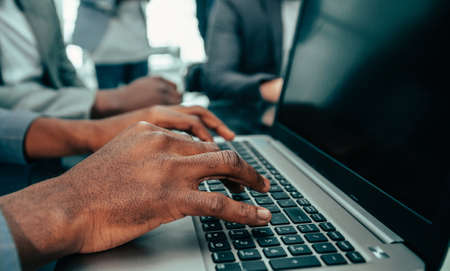 close up. businessman typing on a laptop.